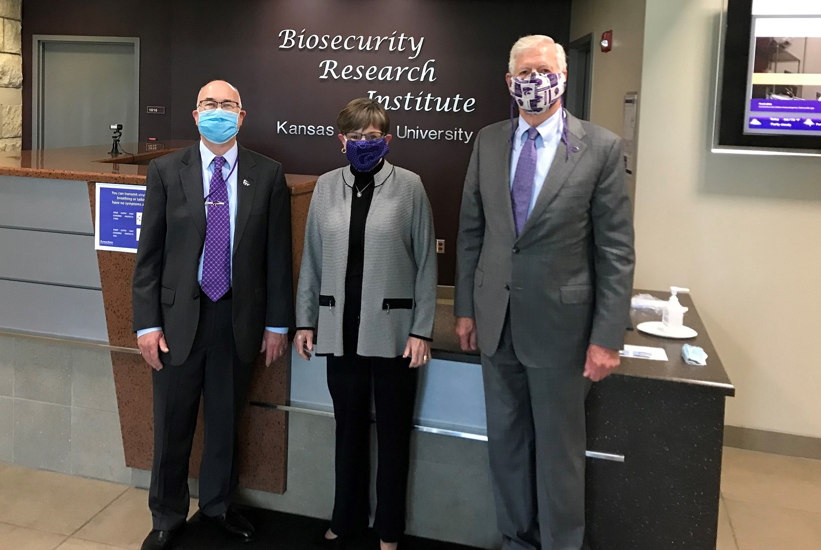 Dr. Higgs, Governor Kelly and President Myers at the Biosecurity Research Institute.